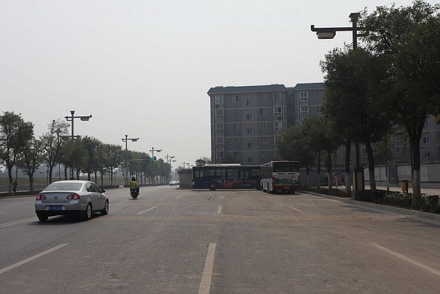 xian road blocked by apartment